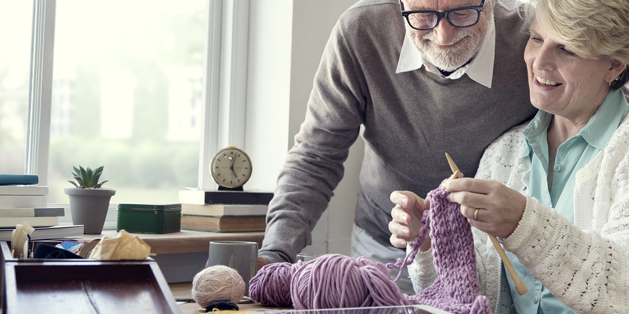 One reason independent living communities in Harvard, Illinois can help seniors feel happier is more time to learn a new hobby, like knitting.